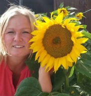 Pernille with sunflower grown in Denmark
