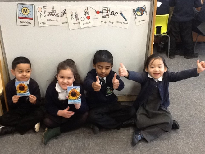 Pupils at Tinsley Meadows with their sunflower seeds.